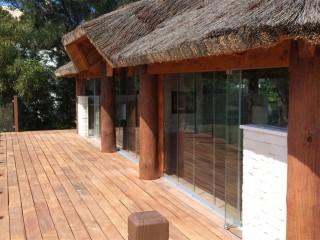wooden floor, wooden ceiling, sliding glass door, winter garden